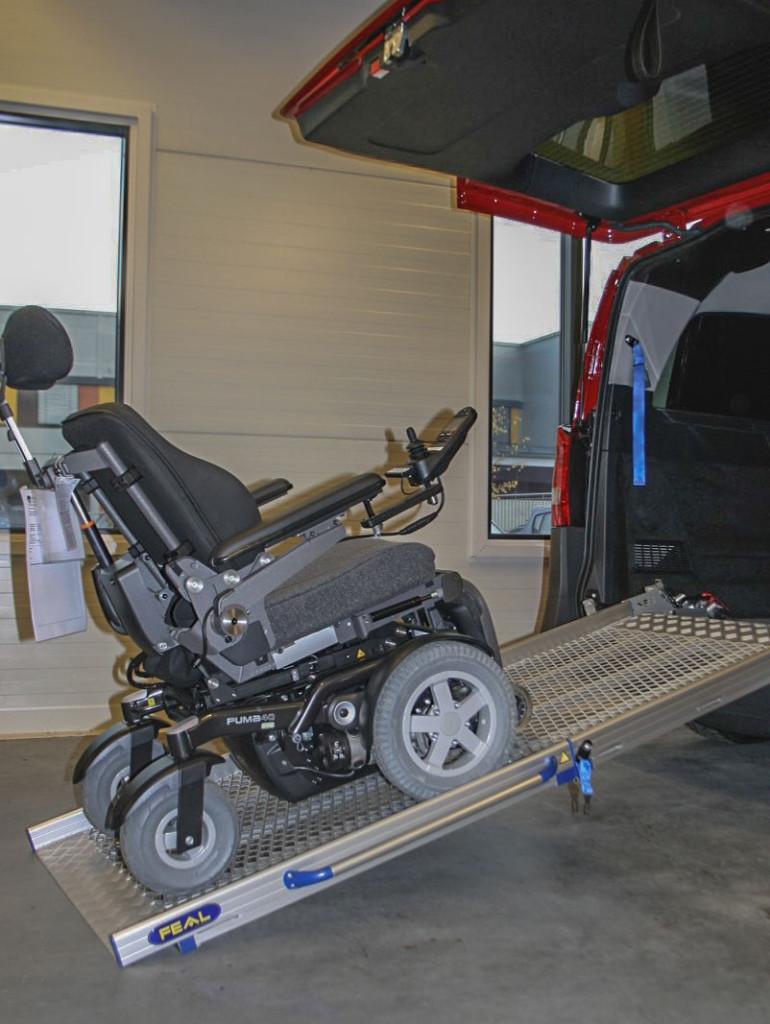 Rampe og elektrisk rullestol